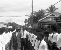 Eric Gairy inspects Bishop's College students.